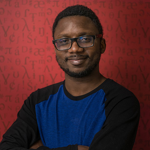 A headshot of Samuel Akinbo, Language Sciences member and Linguistics doctoral student