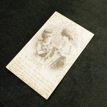A picture of a postcard from 1902 France, containing a secret love message written in code between two women. This postcard is part of the A Queer Century exhibition on display at UBC until August 30 2019.