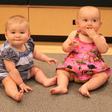 This picture of two babies is used to illustrate the story, which details research suggesting that at an early age, infants are attending to and learning from their environment.