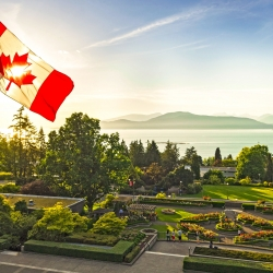 A picture of the UBC Rose Garden, with the Canadian flag in the foreground.