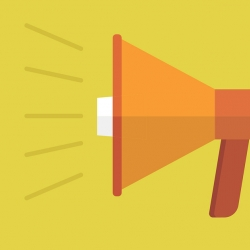 A picture of an orange megaphone against a yellow background.