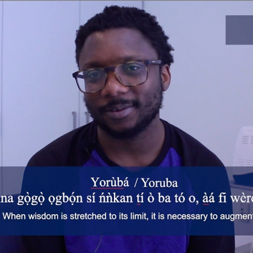 A screenshot of Samuel Akinbo saying his favourite phrase in Yoruba. The phrase is displayed in white across the bottom of the image