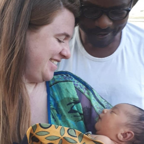 A photo of Monica Shank Lauwo holding her son, Makusaro, with her husband Lauwo