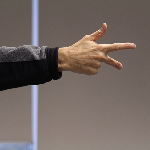 A close up of Nigel Howards hand extended in an ASL sign