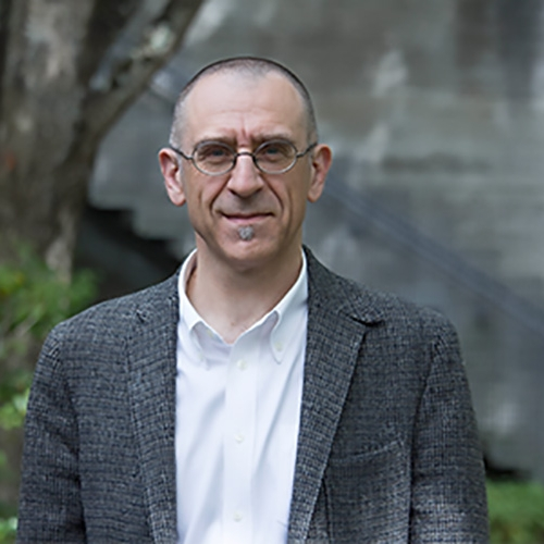 A headshot of Valter Ciocca standing outside