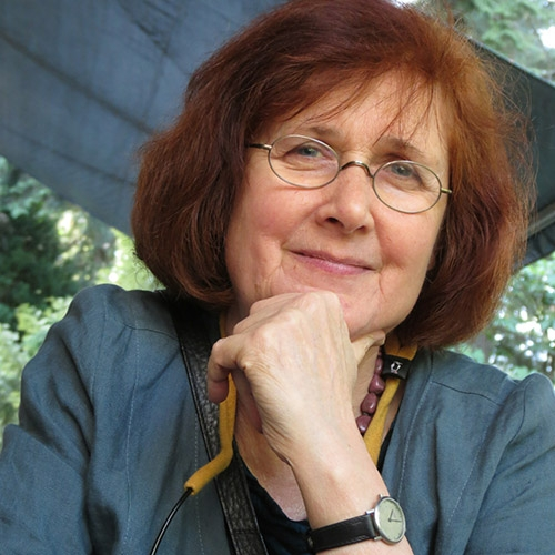 A headshot of Barbara Dancygier with her chin in her hand