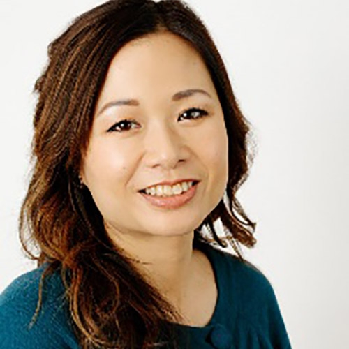 A headshot of Brenda Poon standing in front of a grey background