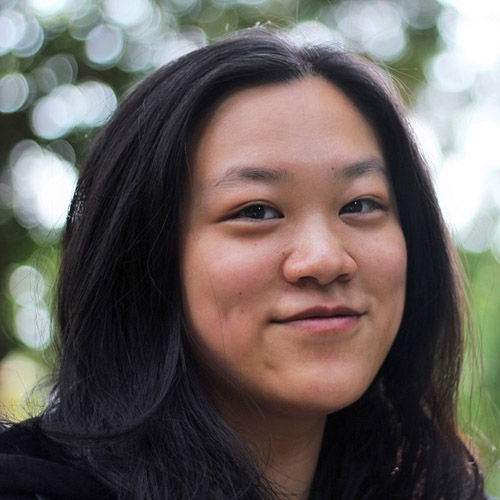 A headshot of Anja-Xiaoxing Cui standing outside