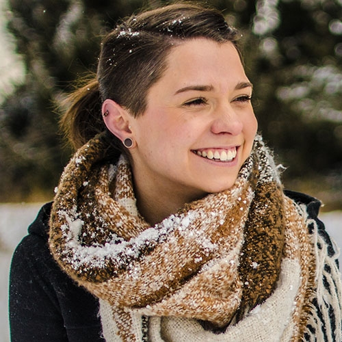 A headshot of Nathalie Czeke sitting outside in the snow