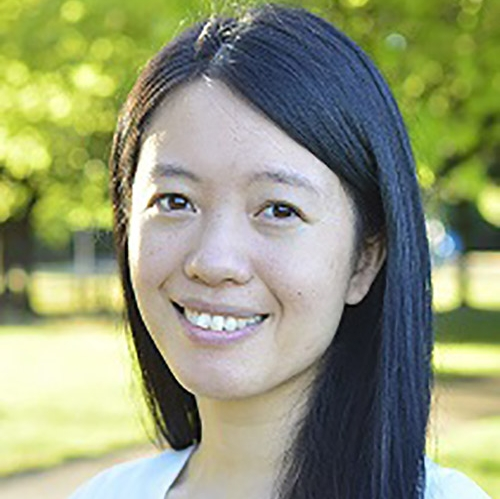 A headshot of Kristina Chang standing outside