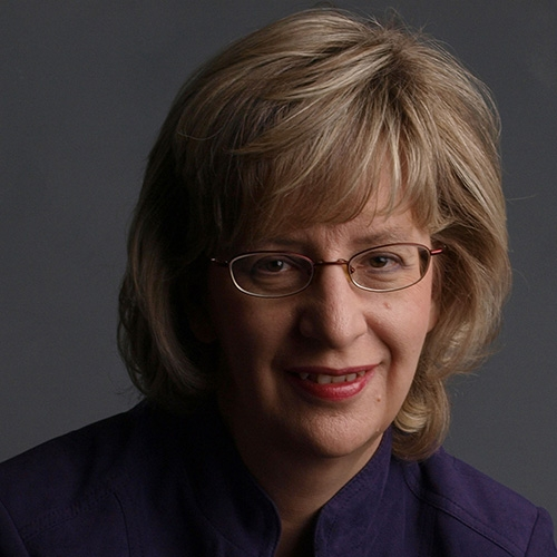 A headshot of Dr. Susan Rvachew against a grey background
