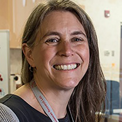 A headshot of Professor Laura Wagner smiling
