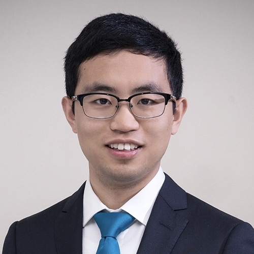 A headshot of Chiyu Zhang standing against a grey background